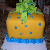 Surprise   3-layer chocolate cake covered with fondant and handmade fondant bow for boy baby shower.