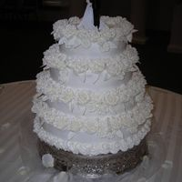 50Th Wedding Anniversary 4-tier stacked b/c with royal icing roses for adornment.