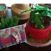In The Jungle 2-tier fondant covered jungle theme cake to coordinate with my son's second birthday invitation at our local zoo. First tier is...