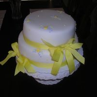 Mini Bouqets   Stacked, fondant covered rounds with piped mini bouqets and ribbon embellishment for bridal shower.