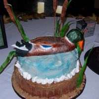 Mallard Duck   Completely edible with exception of skewers in cattails. Made of rice paper, fondant, gumpaste, and rice krispie treats.