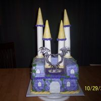 Angels_Wedding_Cake_022.jpg This is a wedding cake that was custom made for a Medieval themed wedding. At the bride and grooms request, the bottom layer is German...