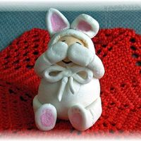 Peek-A-Boo Baby I'm a little bunny today!This is for my grandson's peek-a-boo easter egg. All sugar paste.