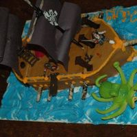 Pirate Ship   Buttercreme icing, piroulene cookies made into cannons, toys added as a present to the birthday boy. He LOVED it.