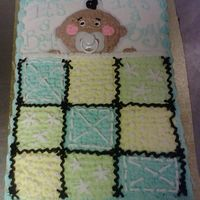 Baby In A Blankie! half vanilla half chocolate cake with buttercreme icing. Design inspired by cakery..thanks!!!