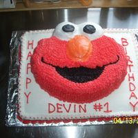 Elmo 1St Birthday Cake bottom level is 11 x 15 half yellow, half chocolate, frosted in buttercream. elmo is party rainbow chip, frosted in buttercream. my hands...