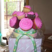 First Cupcake Bouquet .... Well, I tried it. It was easy and fun - need to find a different way to do the tops so they look more like flowers. Even so, my Mom took it...