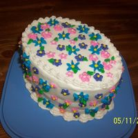 Mothers Day Cake 2007 Just a little cake I whipped up for my Mom tonight. Cinnamon swirl cake with buttercream icing and filling - fun to do!
