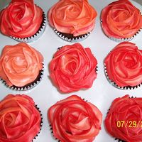 Flower Cupcakes To Go With Mermaid Cake For all the non chocolate lovers (WHAT?) coming to the party, I made some vanilla cupcakes and frosted them in colors to match the flowers...