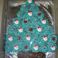 Cupcake Christmas Tree Inspired by all of the other Christmas cupcake cakes I've seen on here, I did this for my sons 1st grade class. He helped me decorate...