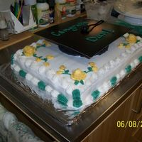"Brothers College Grad Cake So I'm a little happier with this one - not as many problems as the anniversary cake. Chocolate cake 11 x 15 with chocolate 6""..."