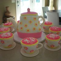Tea Pot And Matching Cups