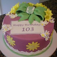103Rd Birthday Cake   Fondant covered with gumpast bow, gumpaste cameo, canterberry bells, daisy, daisy lace and eyelet lace border