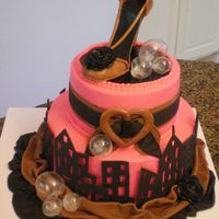 Pink, Brown And Black Bridal Shower  Buttercream with fondant accents, thanks to the NYC skyline that I found on CC, I adjusted the skyline to what I needed, taller and...