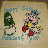 Larry The Cucumber From Veggie Tales Meets Boots From Dora The Explorer Color-Flo cake toppers