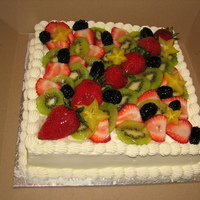 Fruit And Cream Second cake this week using fresh cut fruit. Cake is white sponge, stabilized sweetened whipped cream frosting, cooked custard filling.