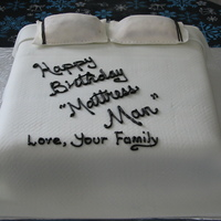 Happy Birthday Mattress Man Mattress cake with buttercream 'mattress' cover and fondant blanket and pillows