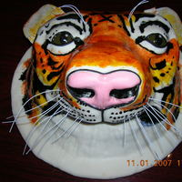 Tiger Head 3D Detailed This was a freebie cake for my then boyfriend but we call it our million dollar cake cuz it took so long to make. all hand painted fondant...