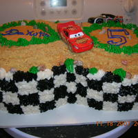 Cars Race Car Track Cars race car track the cake was done in the checkerboard pattern when you cut it open