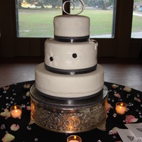Black And White Wedding Botton is coconut cream, top tiers Red velvet this is my first weeding cake was for a friend of my and I never been so nervous glad she...