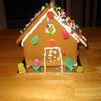 Ginger Bread House  Decorated by my grand daughter, while visiting for winter break. Kept her busy for about 10 min. (smile) She took it apart, in order to put...