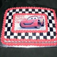 Lightning Mcqueen Iced in buttercream...Then I printed out black and white checks I created in an excel worksheet on an icing sheet and pieced it together...