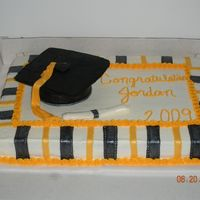 Grad Cake This is the cake I made for my cousin's graduation. I had a lot of trouble with the mortarboard(?). I tried to make it out of fondant...