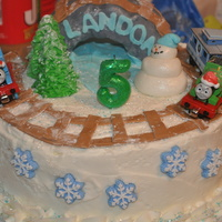 Thomas The Train Birthday This cake was for my son's 5th birthday. He wanted Thomas in the snow so this is what I came up with. I didn't smooth the icing...