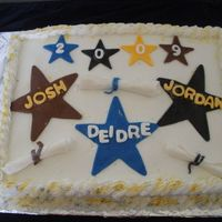 Graduation Cake This was made for a grad. party for three people from three different schools. I had a hard time deciding what to do because of the colors...