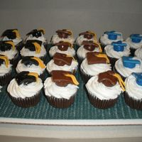 Graduation Cupcakes These were made for a graduation party that was for three different people that were all from different schools. Chocolate cupcakes with...