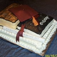 Graduation Cake Large book is apple cake and sheet cake and small book are carrot cake. All are frosted with cream cheese frosting. Tassle and grad hat...
