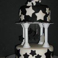 Star Birthday Cake Made for a co-worker who is obsessed with stars and always wears black and white. Cut the star bouquet on top and the dangling stars out of...