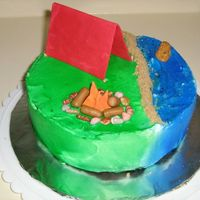 Camping_Cake.jpg Camping cake for my favorite co-worker. It was an idea I had one night when I couldn't sleep (I tend to plan out new cakes when I can...