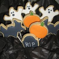 Halloween Bouquet Ghosts, pumpkins and a headstone. Penny's cookie recipe with royal icing.