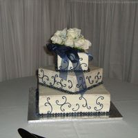 Square Wedding Cake Cake I did for my friend - Butter yellow cake with blueberry jam filling. The trim is fresh blueberries, scrollwork in buttercream. The...