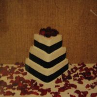 Triangle Cake Vanilla cake with buttercream filling and icing. The wide ribbon (way too wide in my opinion) was insisted upon by the bride, my little...