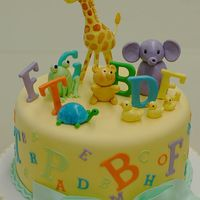 Animal Alphabet Cake These cute baby animals are just learning to spell. The decorations are all made out of fondant.