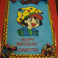 Dakota's Pokemon Cake FBCT Pokemon and character's on buttercream icing. This is my second fbct and so much easier than the first!TFL!