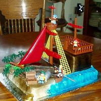 Pirates!   The ship deck is cake and the rest is a cake kit. A fun cake to do.