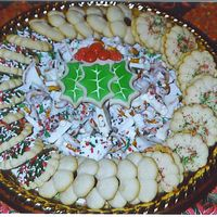Christmas Cookies Tray Spritz cookies, white chocolate Bric-a-Brac and holly leaf sugar cookies.