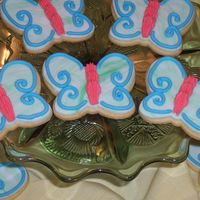 Butterflies Rich rolled sugar cookies with rolled fondant and piped royal icing.