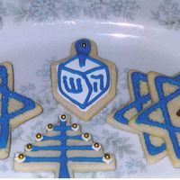 Happy Hanukkah! Sugar cookies with royal icing, dragees and molded Star of David chocolates.