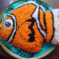 Fish Food Wilton Cake Pan- adapted the Clown Fish instructions to look a little more like NEMO.