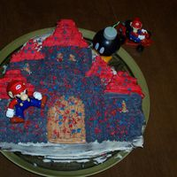 Super Mario Castle Cake Yes, its Mario! He reached Princess Peach's Castle just in time for the birthday party! Wilton Castle Cake Pan