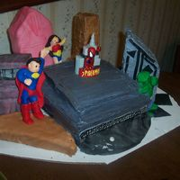 Superhero Cake This is a terrible mess but a good experiment for me. It is a 3-D cake, the buildings are cake some are frosted and some are covered in...