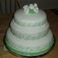 Fondant Wedding Cake Cake for my best friend. White fondant with small green accents. Cake is white with Bavarian Cream filling.