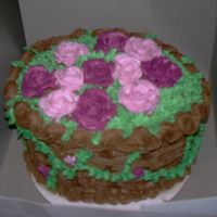 My Neice And Nephew's Birthday  chocolate cake with chocolate buttercream icing and rasberry/chocolate filling. roses are buttercream I feel like I kind of over did the...