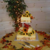 Fall Wedding Cake - Van Gough Theme  French vanilla cake with coconut buttercream, strawberry filling 2 tiers and coconut buttercream bana filling head tier Yellow MMF fondant...