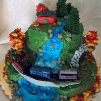 Waterfall With Steam Train This cake was made for my Grandpa who just turned 80. He loves steam trains and used to own a red cabin. The cakes are covered in BC, the...