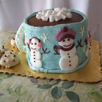 Hot Cocoa Mug This cake is red velvet and white layered. It is coated with cream cheese icing. The hot chcolate is choc. frosting, the cookies are...